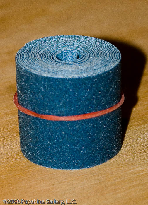 """Roll of emery cloth. This is about 2-3"""" tall."""